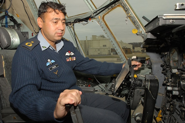 Pakistan air force Wing Commander Hasseb Gul tests flight controls on a C-130 Feb. 8 at Little Rock Air Force Base, Ark. Members of the Pakistani air force visited to observe C-130 operations procedures training. (U.S. Air Force photo by A1C Nathan Allen)