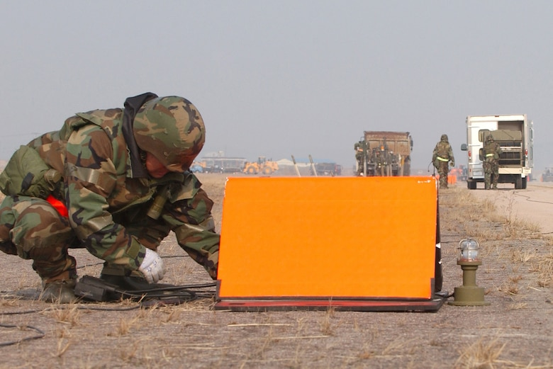 Members of the 8th Civil Engineering Squadron Airfield Damage Repair (ADR) team, install temporary runway lighting during an Operational Readiness Exercise, Wednesday, February 21, 2007 at Kunsan AB, Republic of Korea.  ADR teams do everything from crater repair to airfield lighting making it possible to get aircraft back in the air quickly. (U.S. Air Force Photo/Master Sgt Jack Braden)