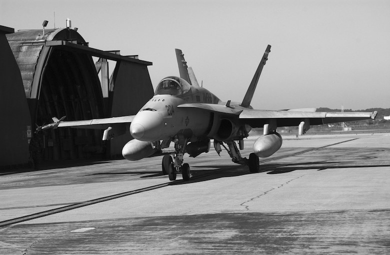 "OSAN AIR BASE, Republic of Korea --  A Marine Corps F/A-18 from the VMFA-155 ""Silver Eagles"" prepares to taxi out onto the runway for a mission. The unit departs Nov. 17 after five weeks of training on Osan. (U.S. Air Force photo by Airman 1st Class Gina Chiaverotti)"