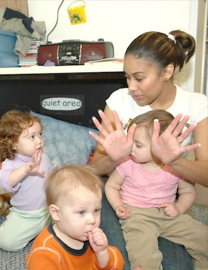 Nancy Gill, Child Development Center program assistant, practices baby sign with children at Fairchild Air Force Base. The CDC is teaching babies and young children approximately 32 sign language signs, modified for children developing motor skills. (Photo by Staff Sgt. Kristian Carter)