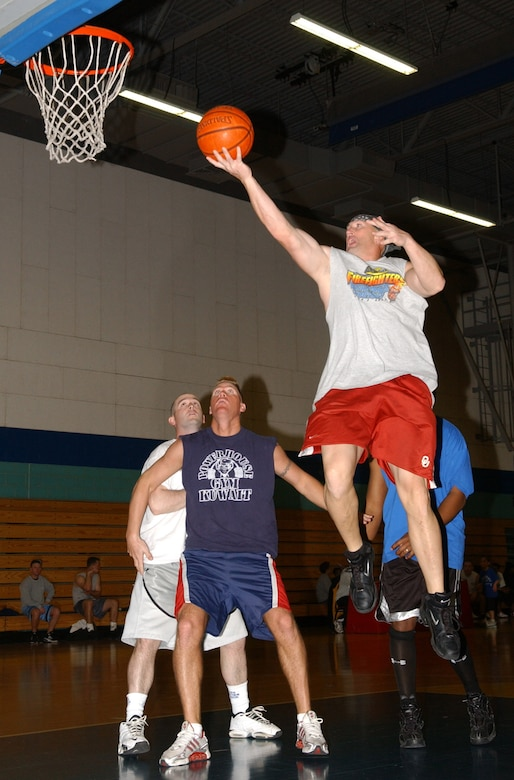 A player goes for a lay-up shot during the 2007 AAHC 3-on-3 Basketball Tourney Saturday at the Mathis Fitness Center.  (U.S. Air Force photo by Airman 1st Class Kamaile Chan)