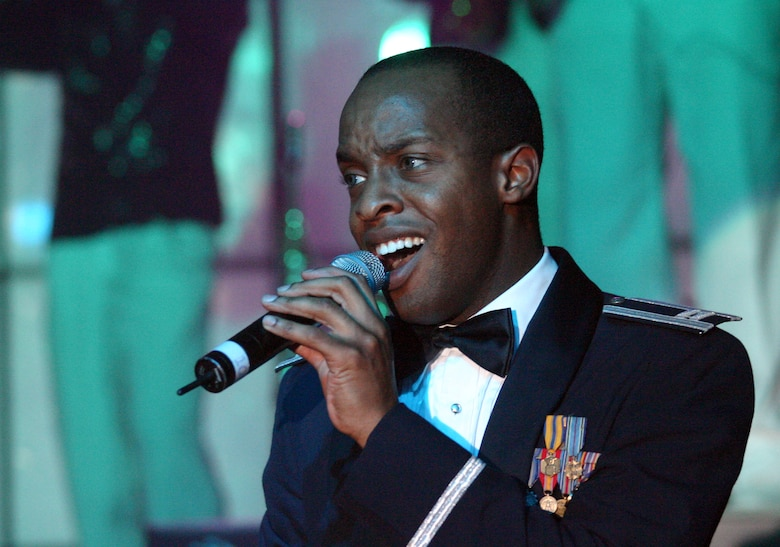 LAUGHLIN AIR FORCE BASE, TEXAS -- Tops in Blue vocalist and operations officer Capt. Sean Carter sings during the concert's finale.  (U.S. Air Force photo by Airman Sara Csurilla)