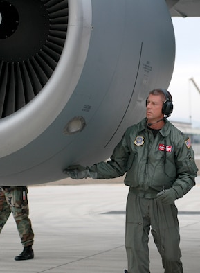 Tennessee Air National Guard member Lt. Col. David Cline, 134th Air Refueling Wing pilot, performs a pre-flight inspection on a KC-135R tanker prior to a training mission here Feb. 14. The Tennesse ANG helped the 31st Fighter Wing fighter squadrons master in-flight refueling during a series of night training missions. (Photo by Senior Airman Lindsay Watson-Kirwin)