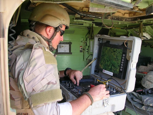 Army Commendation Medal recipient Senior Airman Joshua Wilson, an EOD technician, operates a Talon robot while sitting in a Bradley fighting vehicle while on a mission in Eastern Iraq. The Talon robot is used to render IEDs safe by placing explosive charges on the IED with the arm of the robot.  (U.S. Air Force photo)