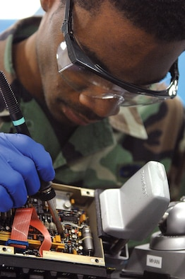 MCCHORD AIR FORCE BASE, Wash., -- Senior Airman Tyran Stockard, 62nd Maintenance Squadron avionics intermediate section technician, replaces the transistor on a line-replacement unit Feb. 5 in the AIS shop located in Bldg. 1119. (U.S. Air Force photo by Abner Guzman)