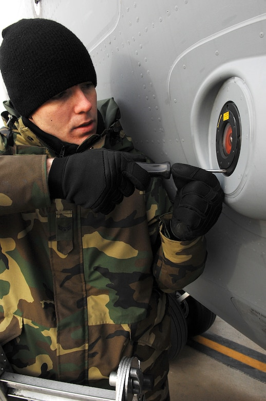 MCCHORD AIR FORCE BASE, Wash., -- Airman 1st Class Daniel Taft, 62nd Maintenance Squadron electronic warfare system technician, installs a LAIRCM on a C-17 Feb. 2 on the flightline. (U.S. Air Force photo by Abner Guzman)