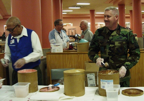 CMSgt. Jeffery K. Bowes, Command Chief MSgt. of 11th Wing, right, is ready to serve ice cream to residents at the Armed Forces Retirement Home in Washington D. C. during the home's monthly ice cream social.  Air Force photo by Capt. Tara Bush