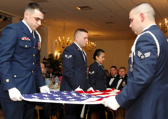 HANSCOM AFB, Mass. -- Members of the recent Airman Leadership School class participate in a flag folding ceremony during their graduation ceremony Feb. 15 at the Minuteman Club. ALS is a five-week course and the first step of Professional Military Education for all enlisted Airmen. The course is required to be taken in residence by active-duty servicemembers prior to being promoted to the rank of staff sergeant and is a requirement for all Airmen to be a rater on Enlisted Performance Reports. U.S. Air Force photo by Mark Wyatt