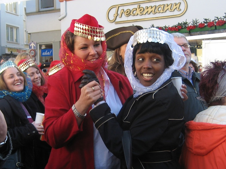 Charlette Banks (right), wife of Col. Sid Banks, 52nd Mission Support Group commander, and Gabi Brown, wife of Chief Master Sgt. Lovorn Brown, 52nd Medical Operations Squadron, enjoy fasching activities in Wittlich, Feb. 15. (US Air Force photo by Staff Sgt. Andrea Knudson)