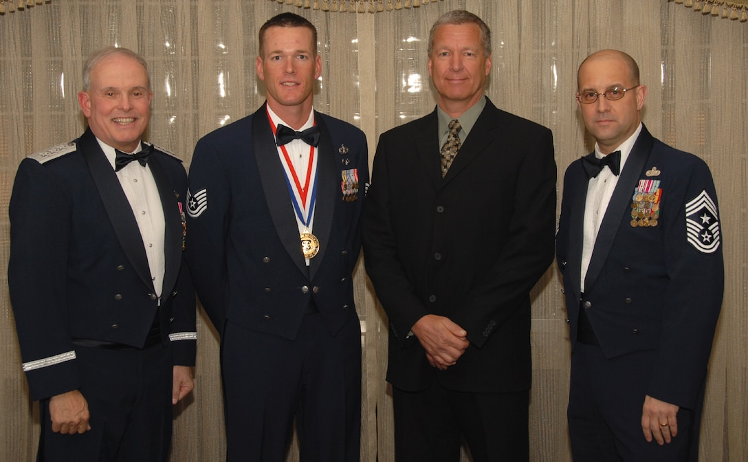 OSAN AIR BASE, Republic of Korea --  Tech. Sgt. Jesse Jacobson, assigned to the Pacific Air Forces Silver Flag Exercise Site in Kadena AB, Japan, is the 7th Air Force annual award winner in the Noncommisioned Officer category. Here he poses with Lt. Gen. Stephen Wood, 7th AF commander, and Chief Master Sgt. Raymond Allen III, 7th AF command chief.