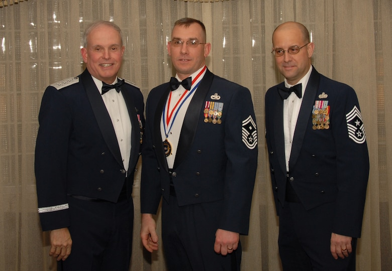 OSAN AIR BASE, Republic of Korea --  Senior Master Sgt. James Winkels, 51st Logistics Readiness Squadron, is the 7th Air Force annual award winner in the First Sergeant category. Here he poses with Lt. Gen. Stephen Wood, 7th AF commander, and Chief Master Sgt. Raymond Allen III, 7th AF command chief.