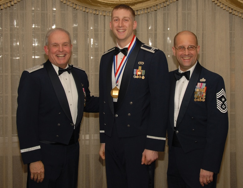 OSAN AIR BASE, Republic of Korea --  Capt. Ryan Crowley, 8th Fighter Wing, is the 7th Air Force annual award winner for the Company Grade Officer category. Here he poses with Lt. Gen. Stephen Wood, 7th AF commander and Cheif Master Sgt. Raymond Allen III, 7th AF command chief.