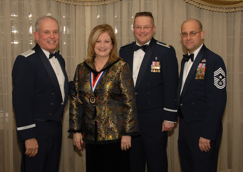 OSAN AIR BASE, Republic of Korea --  Mrs. Sherri Kitchens, 51st Mission Support Squadron, is the 7th Air Force annual award winner in the Civilian Manager/Supervisor/Professional category. Here she poses with Lt. Gen. Stephen Wood, 7th AF commander, and Chief Master Sgt. Raymond Allen III, 7th AF command chief.