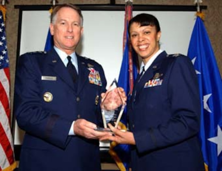 WASHINGTON -- Lt. Gen. John A. Bradley, chief of Air Force Reserve Command, and Col. Stayce Harris, 459th Air Refueling Wing commander, hold the AFRC and 4th Air Force 2006 Effective Maintenance Award. Colonel Harris accepted the award on behalf of the 459th Maintenance Squadron. General Bradley presented the award at the Senior Leadership Conference in Washington Feb. 6. (U.S. Air Force photo/Staff Sgt. Amaani Lyle)