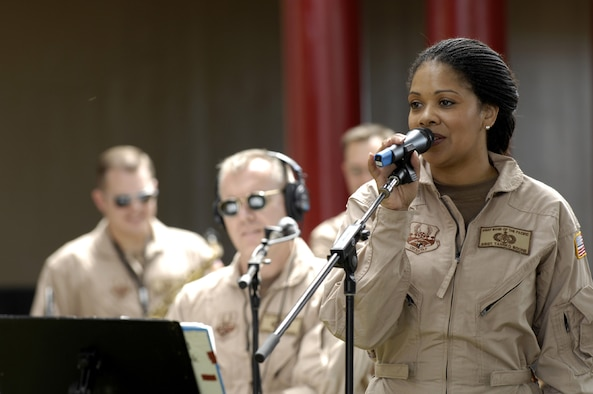 HONOLULU, Hawaii -- Staff Sgt. Tamiko Boone sings during a concert at Radford High School in Honolulu, Hawaii Feb. 15, 2007. The Pacific Air Force Band was on a recruiting drive at the high school. SSgt. Boone is a singer for the PACAF band Hana Hou. (U.S. Air Force photo/ Tech. Sgt. Shane A. Cuomo)