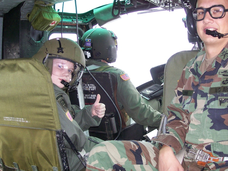 CAMP RUDDER, Fla. -- Riley Woina, 14, from Connecticut, prepares for take-off in a UH-1V Huey air ambualnce from the 5th Aviation Battalion from Ft. Polk, La., here Feb. 21. Riley, diagnosed with cystic fibrosis, was granted a week with the 6th Ranger Training Battalion and Eglin Airmen through the Make-A-Wish Foundation Feb. 19-24. (U.S Army photo by Army Capt. Jeremiah Cordovano)