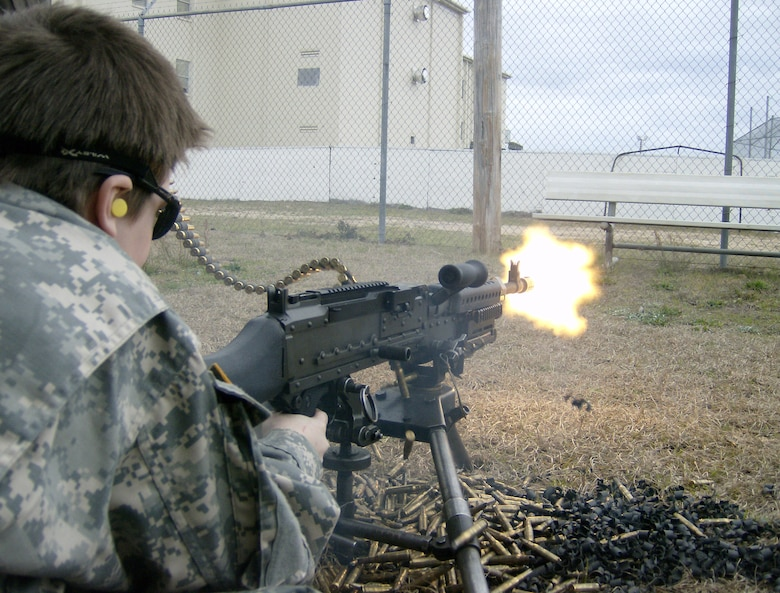 CAMP RUDDER, Fla. -- Riley Woina, 14, from Connecticut, fires a M-249 at the 6th Ranger Training Battalion here Feb. 20. Riley, diagnosed with cystic fibrosis, was granted a week with the 6th Ranger Training Battalion and Eglin Airmen through the Make-A-Wish Foundation Feb. 19-24. (U.S Army photo by Army Capt. Jeremiah Cordovano)