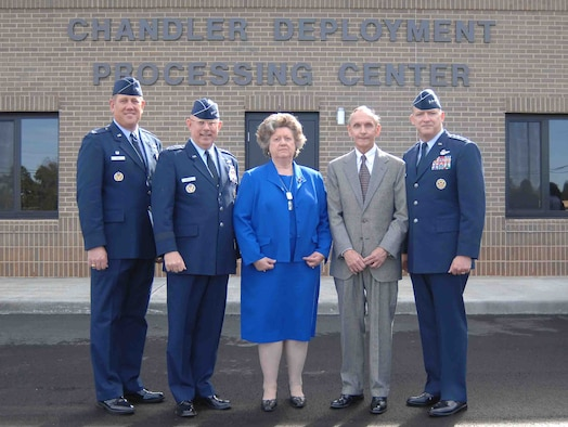 SHAW AIR FORCE BASE, S.C. -- From left, Col. James Hyatt, 20th Fighter Wing commander; Gen. T. Michael Mosley, Air Force chief of staff; Anna and Archie Chandler, and Lt. Gen. Gary North, 9th Air Force and U.S. Central Air Forces commander, stand in front of the Chandler Deployment Processing Center after the dedication ceremony Feb. 26. The Chandler Deployment Processing Center stands as a testament to the Chandlers' faithfulness and dedication to our Airmen performing the Air Force's mission at home and abroad, Colonel Hyatt said during the ceremony. The 40,500-square-foot building includes a state-of-the art mobility bag storage system for more than 10,000 bags, a mechanized weapons storage vault and a passenger holding area for up to 300 people. (U.S. Air Force photo/Airman Mathew Davis)
