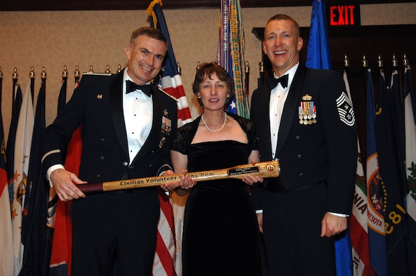 "MINOT, N.D. – Col. Marty Whelan, 91st Space Wing commander, and Chief Master Sgt. Mark Brejcha, 91st SW command chief, present the Civilian Volunteer of the Year award to Pamela McBrien during the 91st SW Annual Awards Banquet at the Holiday Inn in Minot Feb. 23. With the theme, ""Everyday Airmen, Everyday Excellence,"" the 91st SW recognized award winners for their above-and-beyond leadership, job performance, self-improvement and community involvement. (U.S. Air Force photo by Airman 1st Class Cassandra Butler)"
