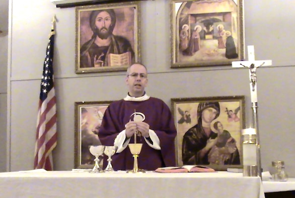 Chaplain (Capt.) James A. Hamel celebrates Mass at Ali Base, Iraq, where he was deployed from September 2006 to January 2007. Father Hamel, a Catholic chaplain assigned to the 11th Wing at Bolling, said he found troop morale at Ali Base the best he has encountered in his three deployments to the region, which included postings to Kuwait, Qatar and the United Arab Emirates.