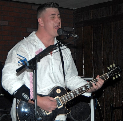 Tech. Sgt. J.D. Morgan, 58th Training Squadron, plays guitar at a show in Albuquerque Feb. 17. Sergeant Morgan formed the band Missing Stateside with Master Sgt. Lawrence D. Willingham while they were stationed at NAS Keflavik, Iceland. (U.S. Air Force photo by Adam Wooten)