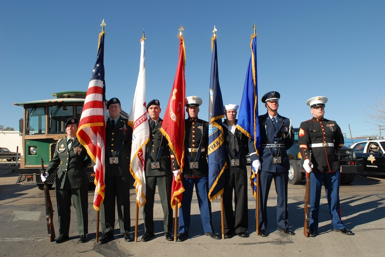 The Goodfellow Joint Service Color Guard stands at parade rest as they await their cute to begin marching Feb 17th in the 2007 San Angelo Live Stock and Rodeo Parade in downtown San Angelo. (U.S. Air Force photo by Tech. Sgt. Randy Mallard)