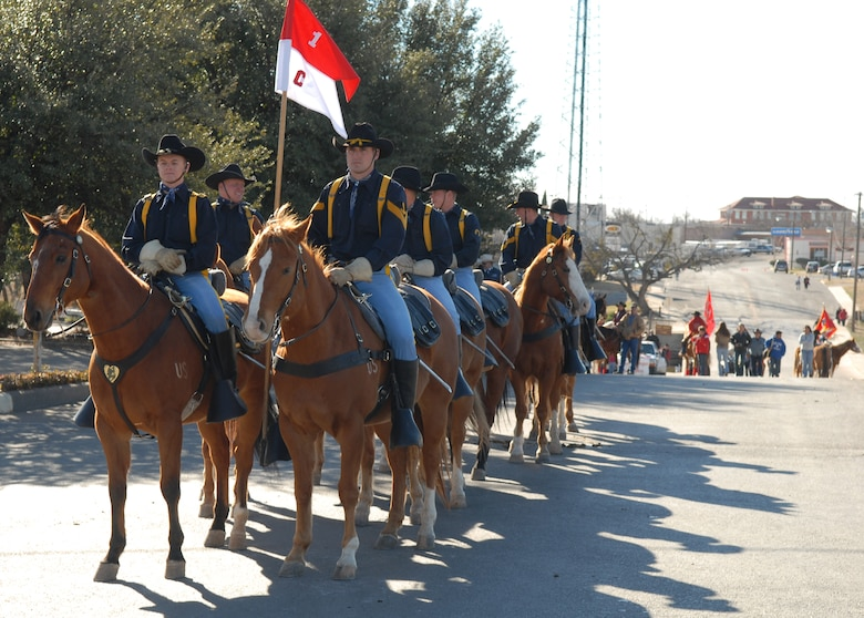 Members of the Horse Cavalry Detachment, First Cavalry Division, from Fort Hood, Texas, begin their march on horseback as they take part in the 2007 San Angelo Live Stock Show and Rodeo Parade Feb. 17 in downtown San Angelo. (U.S. Air Force photo by Tech. Sgt. Randy Mallard)