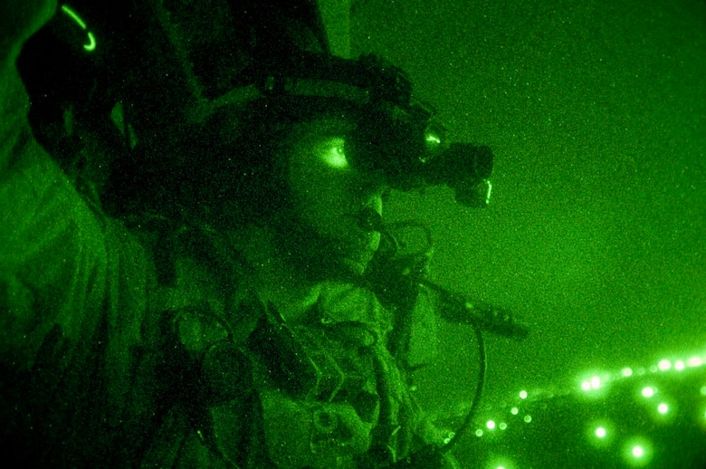 A pararescue jumper, equipped with night vision goggles, scans the Iraqi terrain during a combat search and rescue rehearsal mission Feb. 24 outside Balad Air Base, Iraq. He and his teammates use these rehearsal missions to stay proficient. They are assigned to the 64th Expeditionary Rescue Squadron. (U.S. Air Force photo/Tech. Sgt. Cecilio M. Ricardo Jr.)