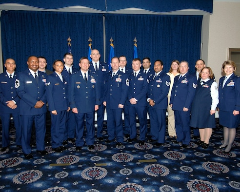 Major General Robert L. Smolen, AFDW commander (third from left) and Colonel Kim M. Johnson, 844th communications group commander (first from right) pose with the 2006 AFDW Communications and Information annual award winners.  (U. S. Air Force photo/Dennis Thomas, 844CG)