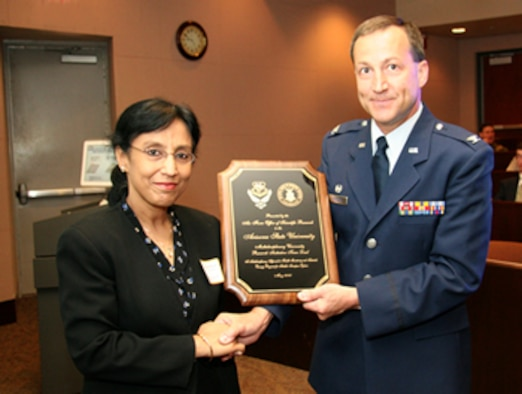 Col. Jeff Turcotte, Deputy Director at the Air Force Office of Scientific Research, presents a plaque to Prof. Aditi Chattopadhyay, Principal Investigator of the aerospace research project at the Ira A. Fulton School of Engineering at Arizona State University, supported by an $8.6 million Department of Defense Multidisciplinary University Research Initiative program grant. (Photo by Kenneth Sweat, Arizona State University)