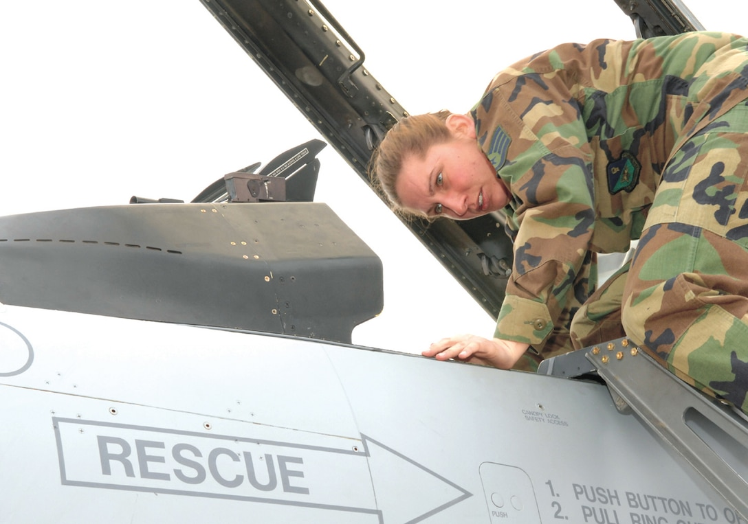 Staff Sgt. Sarah Johnson, 523rd Aircraft Maintenance Unit, performs a final preflight inspection on an F-16 at Cannon Air Force Base, N.M., on Feb. 9 before it is reassigned to the Des Moines Iowa Air National Guard. What was once a 16-day transfer process has been whittled to five days after more efficient methods were developed as part of Air Force Smart Operations for the 21st Century. (U.S. Air Force photo by Airman 1st Class Randi Flaugh)