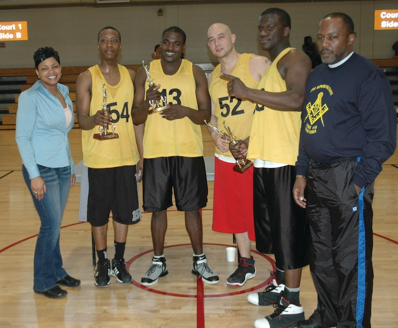 "OSAN AIR BASE, Republic of Korea --  Jamie Sullivan, Brian Commodore, Frank Reyes and William Jackson, members of ""The Winners,"" stand with Malaysia Gresham (left), the African American Heritage Month Committee president, and Timothy Finney (right), the Otis Hopkins Military Lodge No. 10 president.  The team poses with their trophies after winning the a 3-on-3 basketball tournament Feb. 19. The AAHMC, along with the Otis Hopkins Military Lodge and Order of Eastern Stars, sponsored the tournament. (U.S. Air Force photo by Senior Airman Brok McCarthy)"