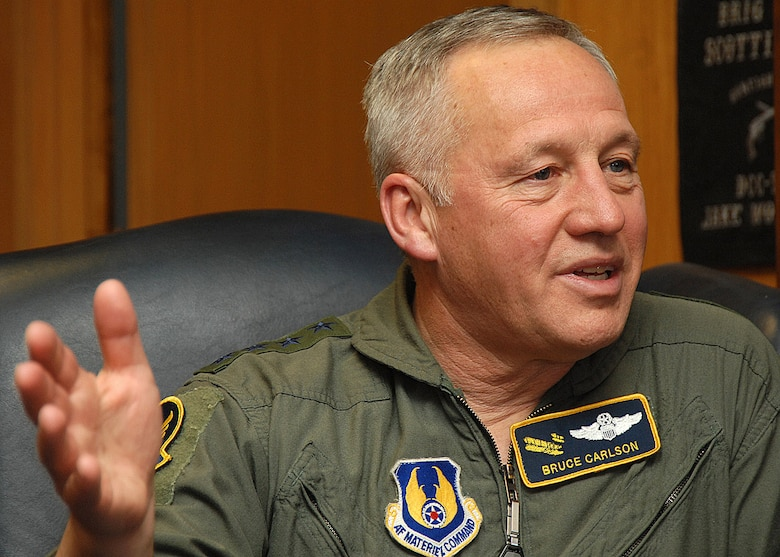 Gen. Bruce Carlson discusses the contributions of Airmen from Air Force Materiel Command toward the war on terrrorism Feb. 21 at Kirtland Air Force Base, N.M. The AFMC commander visited Airmen throughout Southwest Asia in January. (U.S. Air Force photo/Todd Berenger)