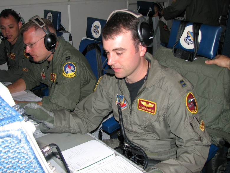 From left, Captains Matt Ketchie, Tim Higgins and Patrick McSherry work during an E-3 Sentry mission Dec. 21 over Ecuador. The three are deployed to Manta Forward Operating Location, Ecuador, from Tinker Air Force Base, Okla. Captain Ketchie and McSherry are air weapons officers, and Captain Higgins is a senior director. The Airmen coordinate with agencies to provide better imagery. (U.S. Air Force photo/2nd Lt. Amber Balken)