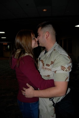 Senior Airman Francisco Salcedo, 28th Civil Engineer Squadron, hugs his wife Amber after returning Dec. 22 from a 7-month deployment to Contingency Operating Base Speicher, Iraq. Airman Salcedo was one of 42 28th CES Airmen deployed in support of the continuing global war on terrorism and responsible for maintaining base infrastructure in their overseas location.