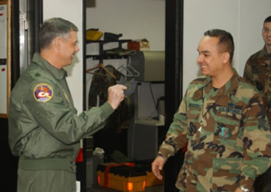 MISAWA AB, JAPAN -- Brig. Gen. Sam Angelella, 35th Fighter Wing and installation commander, surprises Staff Sgt. Jason Benavides, 35th Aircraft Maintenance Squadron, with a STEP promotion here Dec. 22. STEP promotions are a rare reward for hard working members of the enlisted Air Force.