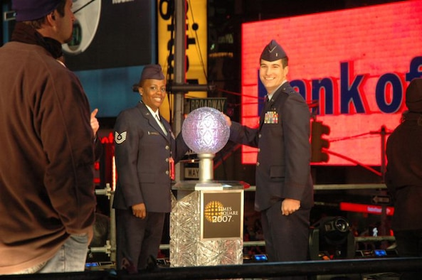 "Tech Sgt Sonya Bulluck, Aerial Port Specialist with the Air Force Reserve Command's 514th Air Mobility Wing and 1st Lt. Erick Saks, 305th AMW, McGuire Air Force Base, N.J., pose with the ""Big Apple Button"" that they helped push to ring in the New Year in Times Square, New York City. The McGuire airmen were selected as honorees of New York Mayor Michael R. Bloomberg.  They joined nine other servicemembers from all branches of the military.  Festivities included helping Mayor Bloomberg push the button to drop the ball at midnight as well as numerous media interviews including a live interview on NBC's Carson Daly show. (U.S. Air Force photo/Senior Airman Rachel Bernardez)"