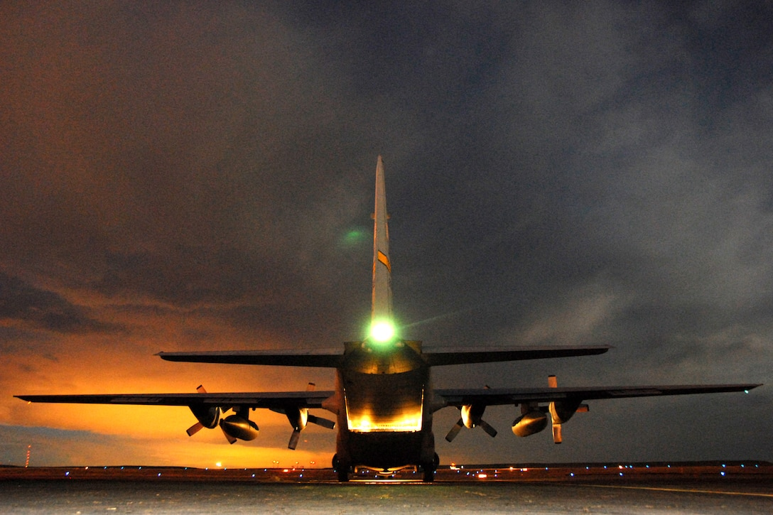 A Wyoming National Guard C-130 Hercules from Cheyenne prepares to depart Jan. 3 from Pueblo, Colo., after being loaded with six one-ton bales of hay. The hay is intended for cattle stranded by a winter storm in southeastern Colorado. The aircraft was loaded in the evening after the last drop of the first day so it would be ready to go early on the second day. It would land again at Pueblo for more missions and drops as time and weather permitted. (U.S. Air Force photo/Senior Master Sgt. John Rohrer)