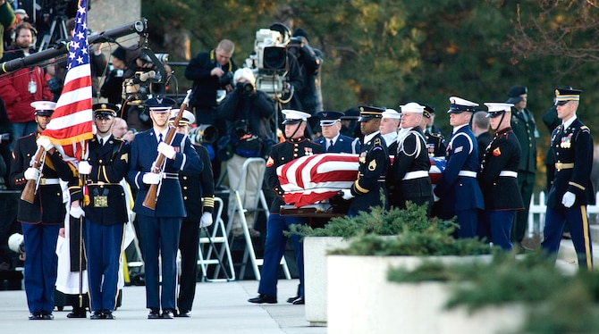 Armed Forces Honor Guard and body bearers carry President Gerald R. Ford for his internment at the Gerald R. Ford Presidential Library and Museum Jan. 3 in Grand Rapids, Mich. (U.S. Air Force photo/Tech. Sgt. Cecilio M. Ricardo Jr.)