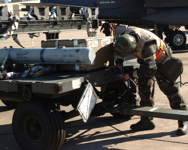 A 336th Weapons Airman unhooks a missile from a cart during the ORE December 12. The exercise is preparation for an operational readiness inspection January 23-26 that will evaluate the 4th Fighter Wing's ability to employ aircraft and resources, survive and operate, conduct mission support activities in a steady state combat environment, and to provide training opportunities to improve on existing capabilities. (US Air Force photo by Senior Airman Micky Bazaldua)(released)