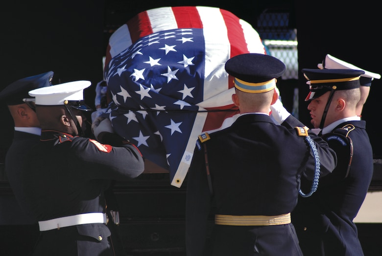 ANDREWS AIR FORCE BASE, Md --The casket bearers from the Joint Service Honor Guard place the casket of former President Gerald R. Ford into the loader during the departure ceremony held in his honor Tuesday. (U.S. Air Force photo by Tech. Sgt. Christopher J. Matthews)(RELEASED)