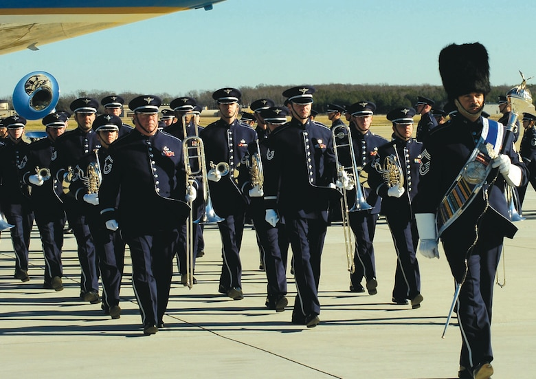 """ANDREWS AFB, Md. -- The U.S. Air Force Band, Bolling Air Force Base, Washington, marches off the flight line Tuesday after playing """"Ruffles and Flourishes,"""" """"Hail to the Chief"""" and """"Goin' Home"""" during the departure ceremony for former President Gerald R. Ford. (U.S. Air Force photo by Bobby Jones)(Released)"""