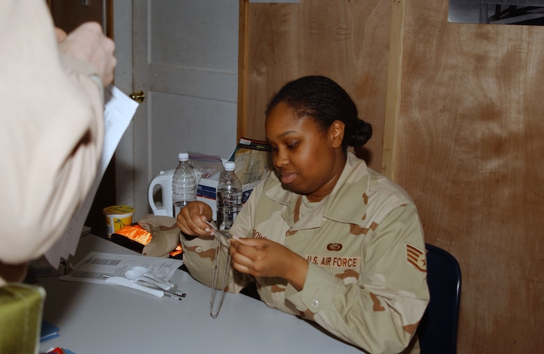 BALAD AIR BASE, Iraq -- Staff Sgt. Shereka Brown 332nd Expeditionary Mission Support Group PERSCO team member, verifies identification information Jan. 2. Sergeant Brown is deployed from Andrews Air Force Base, Md. (U.S. Air Force photo by Staff Sgt. Alice Moore)