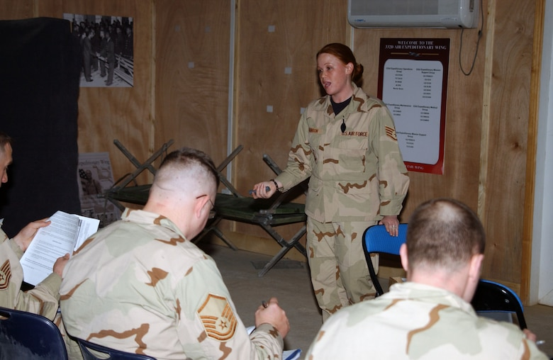 BALAD AIR BASE, Iraq -- Staff Sgt. Channa Johnson, 332nd Expeditionary Mission Support Group PERSCO team member, briefs Airmen upon their arrival to Balad Air Base, Jan. 2. Sergeant Johnson is deployed from Charleston Air Force Base, S.C. (U.S. Air Force photo by Staff Sgt. Alice Moore)