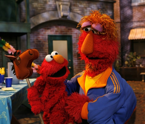 """Elmo talks with his father before he goes overseas during a portion of the """"Talk, Listen, Connect: Helping Families During Military Deployment? program."""