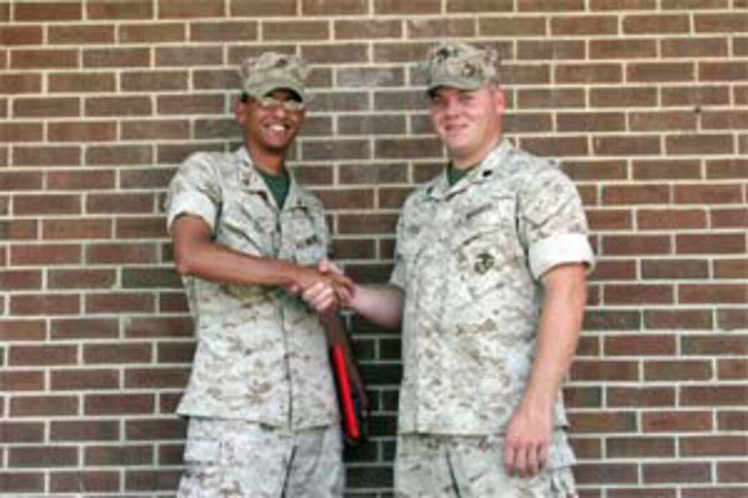 MARINE CORPS BASE CAMP LEJEUNE, N.C. (June 8, 2007)?Lance Cpl. Juan A. Valdez (left), a mortarman with Weapons Company, 2nd Battalion, 8th Marine Regiment, 2nd Marine Division, shakes hands with Sgt. Jesse E. Leach, the section leader for Mobile Assault Platoon 4, Weapons Co., after receiving a Purple Heart Medal here, June 8. The Boston native credits Leach for saving his life after he was struck by a sniper round while on patrol with his unit in Al Karmah, Iraq, in support of Operation Iraqi Freedom.
