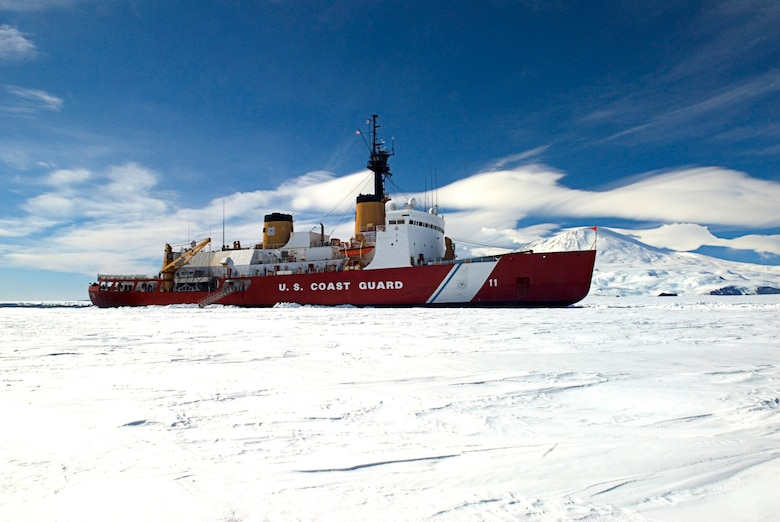 ANTARCTICA - The Coast Guard Cutter Polar Sea pauses from its ice-breaking duties in front of Mt. Erebus, while members of the National Science Foundation came aboard to meet with senior officers.  The Polar Sea is in Antarctica as part of the Air Force-led Joint Task Force Support Forces Antarctica, Operation Deep Freeze 2007, clearing a navigable channel for supply ships to get needed equipment and goods to scientists working in McMurdo. U. S. Coast Guard photo by Petty Officer 3rd Class Kevin Neff.