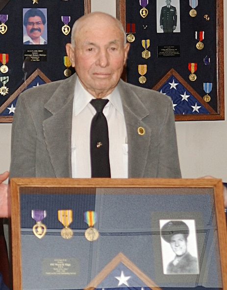 """Wayne Higgs, a World War II veteran of Iwo Jima, was inducted into the Cannon  Airman Leadership School's Hall of Heroes during ceremonies Dec. 7 at Cannon Air Force Base, N.M. Mr. Higgs is the 18th veteran to be inducted into the hall, which began as a """"Wall"""" of Heroes in 2004.(Air Force photo by Staff Sgt. April Wickes)"""