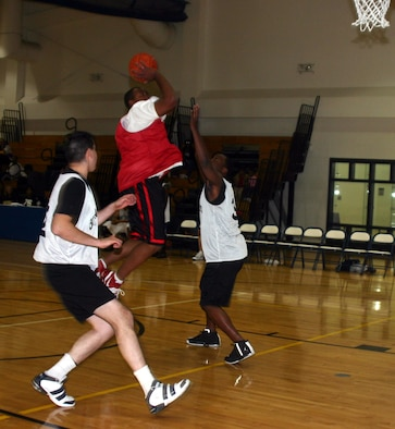 Jamar Davis, 82nd Contracting Squadron, makes a jump shot in the 82nd CONS game against the 82nd Medical Operations Squadron Jan. 8. The 82nd CONS won 67-30, taking their record to 5-0.
