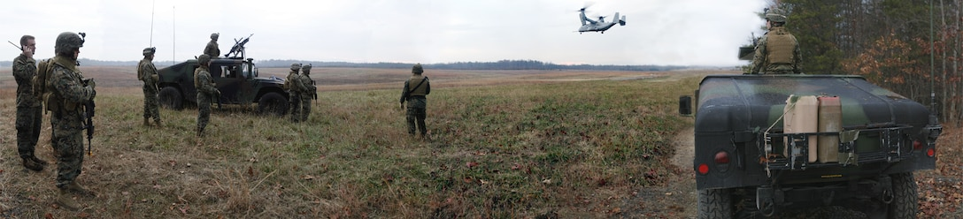 Marines with 3rd Battalion, 6th Marine Regiment, 2nd Marine Division, II Marine Expeditionary Force, watch from afar as an MV-22 Osprey completes an insertion and extraction for Companies K and L during a raid exercise here Dec. 10. The battalion recently completed a two-week combat training evolution away from their home, Marine Corps Base Camp Lejeune, N.C.
